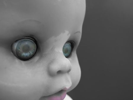 Portrait of an old doll with selective color
