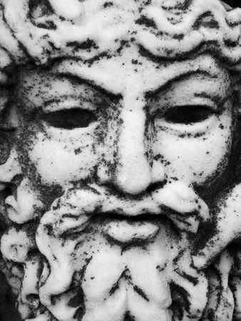 chiseled: Close up of a granite carved face Stock Photo