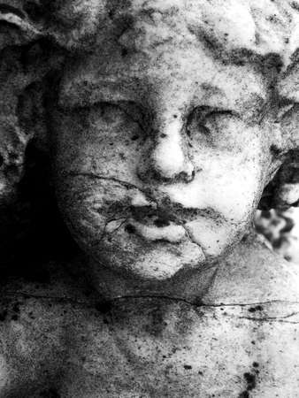 Close up of a granite carved face Фото со стока