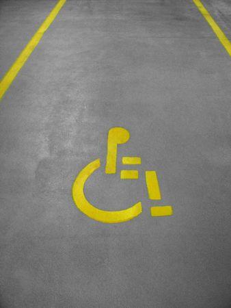 A handicap parking space in a parking garage
