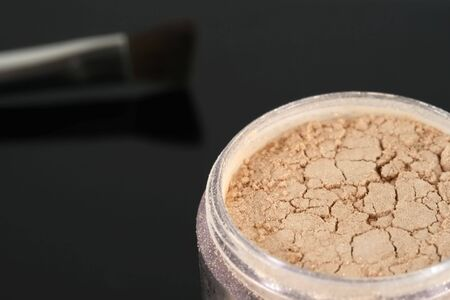 Professional cosmetic face and body glitter powder and brush Stock Photo