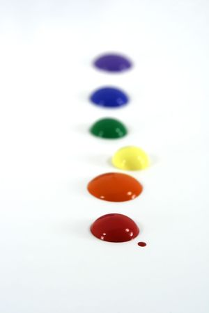 Primary colored paint splatters on white