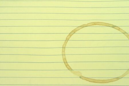 a blank lined page with a coffee stain ring