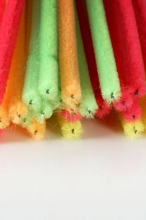 brightly: A bunch of brightly colored craft pipe cleaners