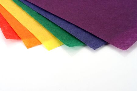 a stack of brightly colored craft paper