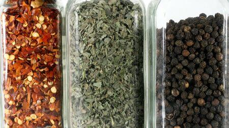 Glass bottles on the spice rack 版權商用圖片