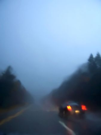 A raining night on the road with bad visibility Banco de Imagens