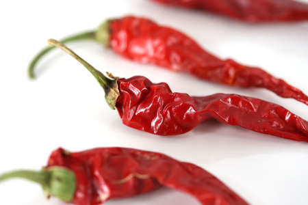 Spicy red chili peppers on a white background