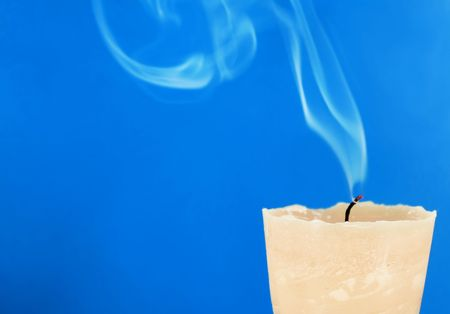 A close up of a smoking candle after being blown out Stock Photo - 888207