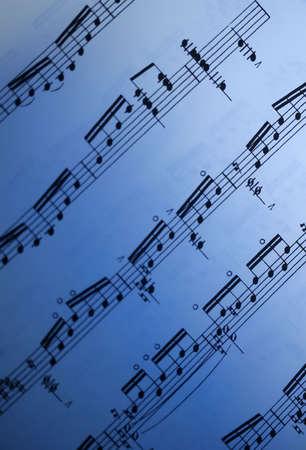 Sheet music with a blue gradient effect Banco de Imagens