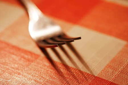 Close up of a fork on a picnic table with shallow DOF Stock Photo - 980938