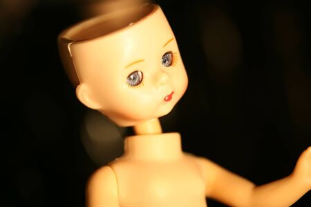 Close up of a doll with missing parts photo