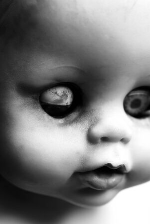 Close up of an old dirty doll photo