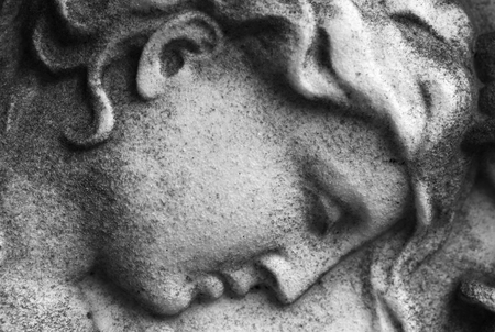 Close up of a stone carved face of an  angel