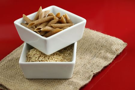 Healthy whole wheat pasta and brown rice Stock Photo