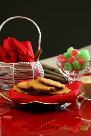 An elegant holiday dessert table with cookies and candy