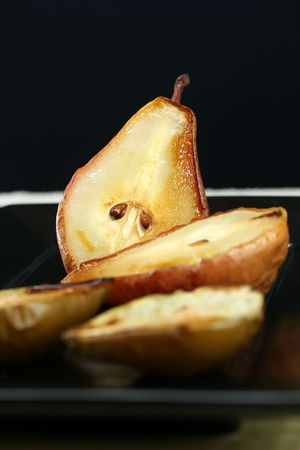 A platter of healthy gourmet baked pears Stock Photo