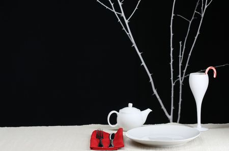A modern Christmas table setting for one Stock Photo