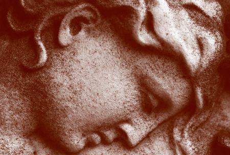 Close up of a stone carved face of an  angel photo