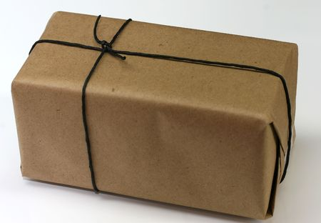 a box with plain brown wrapping paper tied with black string