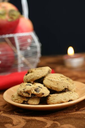 A plate of chocolate chip cookies for dessert