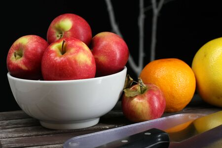 Apples, oranges, grapefruits, healthy fruit on a picnic table Stock Photo