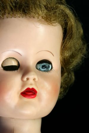 Close up of a winking dolls face photo