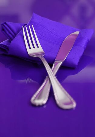 A bright and colorful table setting in purple