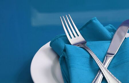 A colorful table set with plate, knife, fork and napkin Imagens - 2428163