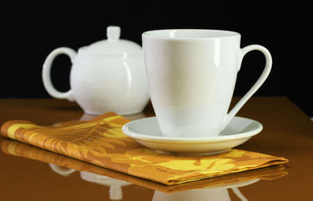 A coffee cup and teapot set on an orange table Stock Photo - 2428165