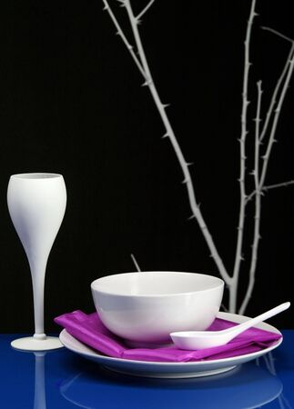 A Modern dinning table set in blue and purple