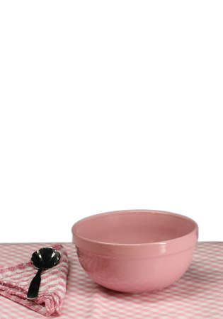 A pink picnic table setting with a white background