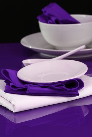 A table setting with modern dishes and napkins Stock Photo