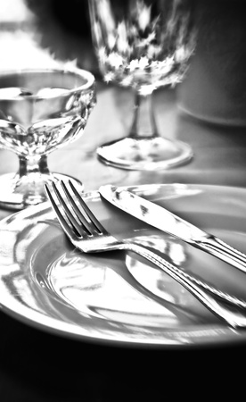 dinning table: A table setting in black and white with selective focus