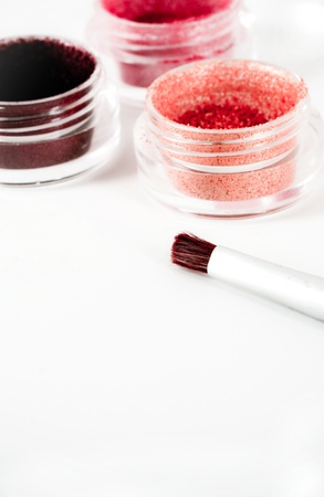 glitter makeup: pink and brown toned make-up and brush Stock Photo