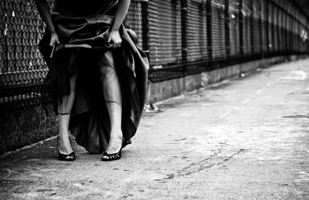 A black and white fashion photo of a woman in an evening gown in an urban setting Stock Photo - 22091777