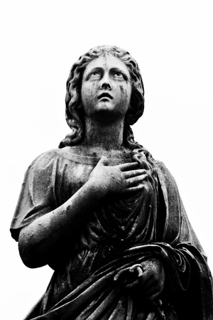 divinity: A statue of an angel with her hand over her heart