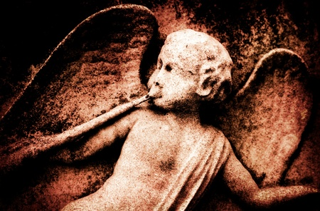 chiseled: A deteriorating stone angel in red tones