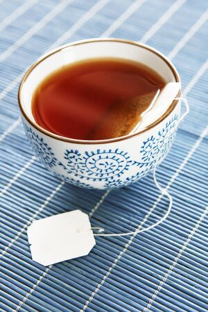 teabag: A detail of a cup of tea with blank label for copy Stock Photo