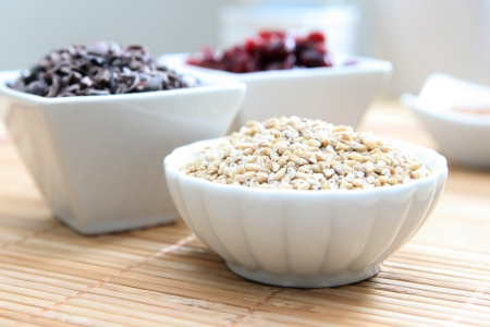 A studio shot of healthy whole grains, dried cranberries and cacao nibs