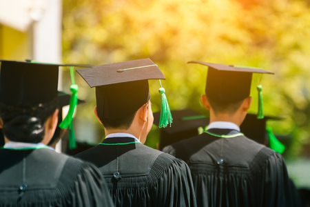 Rear view of Graduates join the graduation ceremony at the university. Education concept.