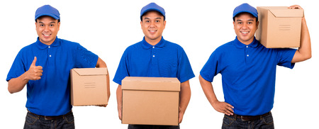 Young asian delivery man in blue uniform Banco de Imagens