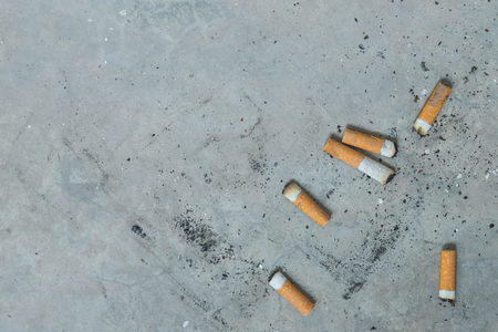 Cigarette butts with blank space. Stock Photo