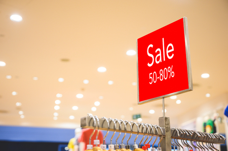 Sale 50-80% off mock up advertise display at clothes line in the shopping department store. Shopping concept.
