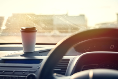 Coffee paper cup in car 写真素材