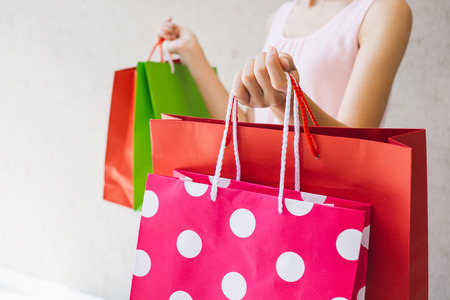 Close up of woman hand holding shopping bags. Stok Fotoğraf