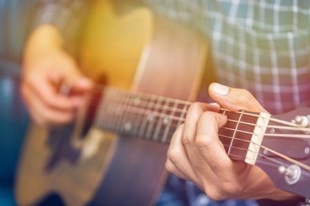 Close up man playing guitar 写真素材