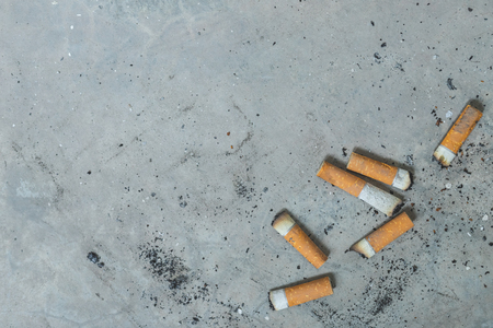 Cigarette butts with blank space. Imagens