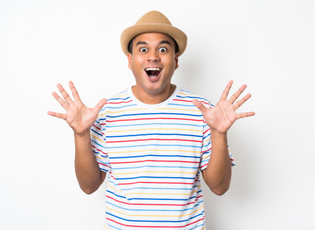 Young Asian man with hat feels shock and surprise with overly face expression.