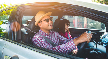 Happy moment couple asian man and woman sitting in car. Enjoying travel concept.